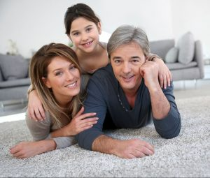 Family laying on newly installed carpet